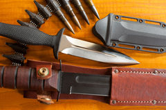 Military knives and scabbard on the wooden background Royalty Free Stock Images