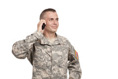 Soldier talks on a Cellphone Stock Photo
