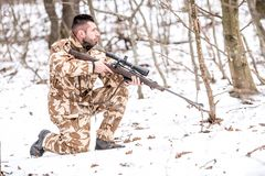 Military man in combat, camouflage uniform preparing for battle with enemy. Military man in combat, camouflage uniform preparing for battle Stock Image