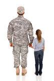 Military man and daughter. Rear view of military men and daughter on white background Royalty Free Stock Photography