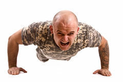 Military man exercise. Isolated in white Royalty Free Stock Photo