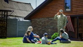 Military man with family in backyard stock photo