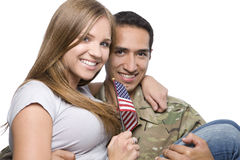 Military Man has Happy Wife in His Arms royalty free stock photo