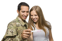 Military Man and His Wife Smile at Pregnancy Test Stock Images