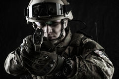 Military man in italian camouflage aiming from handgun Royalty Free Stock Images