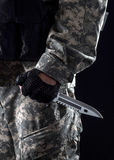 Military man with a knife in a hand close up Royalty Free Stock Photos