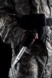 Military man with a knife in a hand close up royalty free stock photo