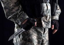 Military man with a knife in a hand close up stock photos