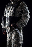 Military man with a knife in a hand close up royalty free stock photography