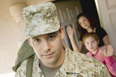 Military Man Leaving House Royalty Free Stock Images