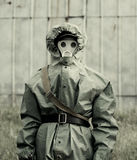 Military man in protective suit and gas mask outdoors Royalty Free Stock Photo