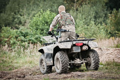 Military man on quad - patrolling area royalty free stock photography