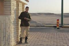 Military man at roadblock Stock Photo