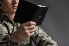Military man sitting and holding the book royalty free stock images
