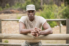 Military man standing during obstacle course in boot camp Stock Photo