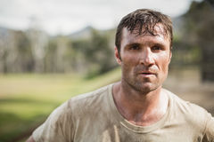 Military man standing during obstacle course in boot camp. Portrait of military man standing during obstacle course in boot camp stock images