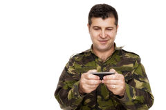 Military man texting on phone Royalty Free Stock Photography