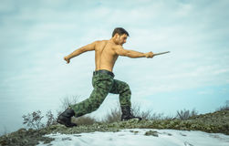 Military  man training martial arts in nature Royalty Free Stock Photography