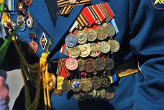 Military man uniform decorated by many awards. Royalty Free Stock Photography