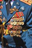 Military man uniform decorated by many awards. Royalty Free Stock Photos