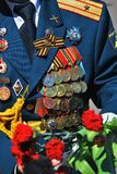 Military man uniform decorated by many awards. Royalty Free Stock Image