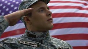Military man in uniform saluting on american flag background, rewarding day