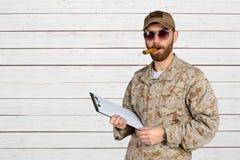 Military man in uniform using cigar Royalty Free Stock Photos
