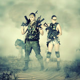 Military man and woman Stock Images