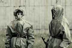Military mans in protective suit and gas mask outdoors.  Royalty Free Stock Photography