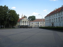 Military marching through the city Stock Image