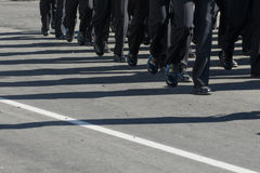 Military marching formation.Shadows on the road. Horizontal Royalty Free Stock Images