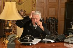 Military mature general calls on the phone Royalty Free Stock Photo