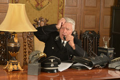 Military mature general. Military mature  calls on the phone in his office Stock Photos