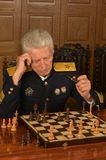 Military mature general playing chess Royalty Free Stock Images