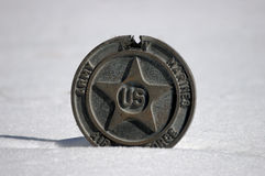 Military medal. Partly buried in snow Stock Images