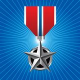 Military medal on blue starburst Stock Photo