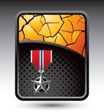 Military medal on cracked gold backdrop Royalty Free Stock Image