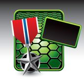 Military medal on green hexagon template Stock Image