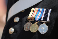 Military Medals. Three military medals displayed on the chest on a British soldier Stock Image