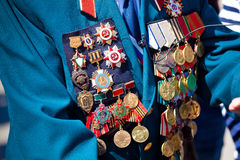 Military medals on the jacket of veteran Stock Photography
