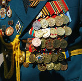 Military medals on the jacket of a war veteran. Stock Image