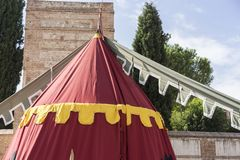 Military,medieval tent of different colors with coats of arms an Stock Photos