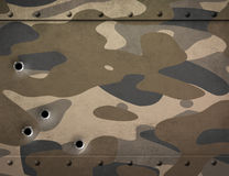 Military metal with camouflage and bullet holes 3d illustration Stock Images
