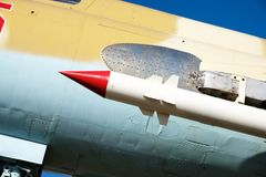 A military missile is located on the wing of a fighter plane, military armament. On a Russian airplane Stock Photo