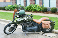 Military Motorcycle. A motorcycle with a military look to it, parked on the side of the road stock photos