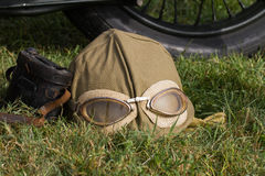 Military motorcyclist helmet and glasses Stock Photography