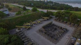 Military museum exhibits Victory park Kyiv city. Aerial view Kiev Pechersk lavra. Military museum exhibits in Victory park Kyiv city, Ukraine. Aerial view stock footage