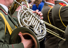 Military musicians playing french horns on parade Stock Photography