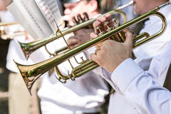 Military musicians playing gold trumpets on music festival Stock Photos