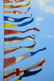 Military naval flags against the sky Stock Images